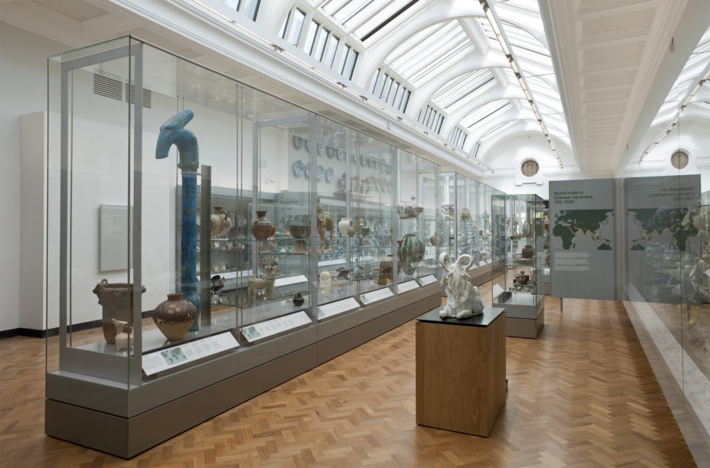 photograph of interior of large museum gallery displaying ceramics