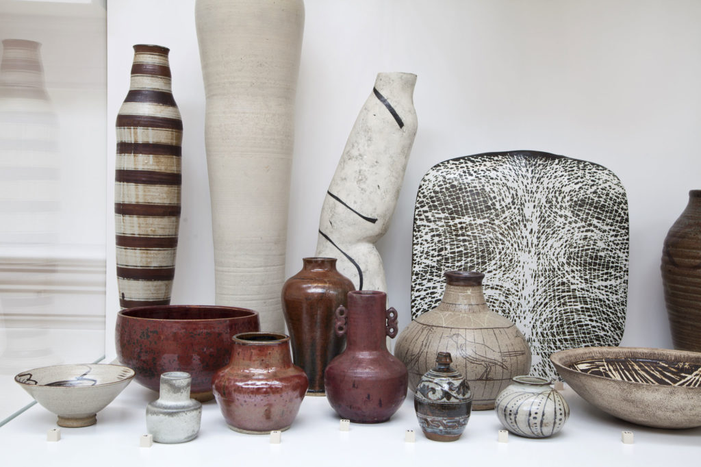 photograph of modern ceramic vessels in white display