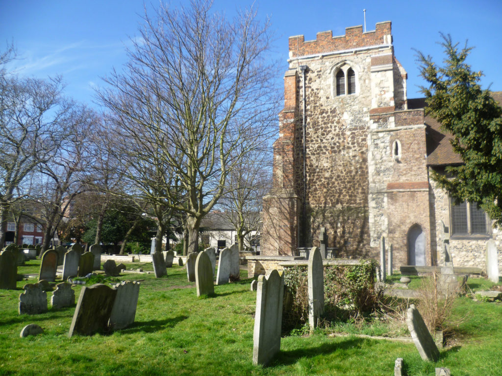 photograph of churchyard with headstones in foreground