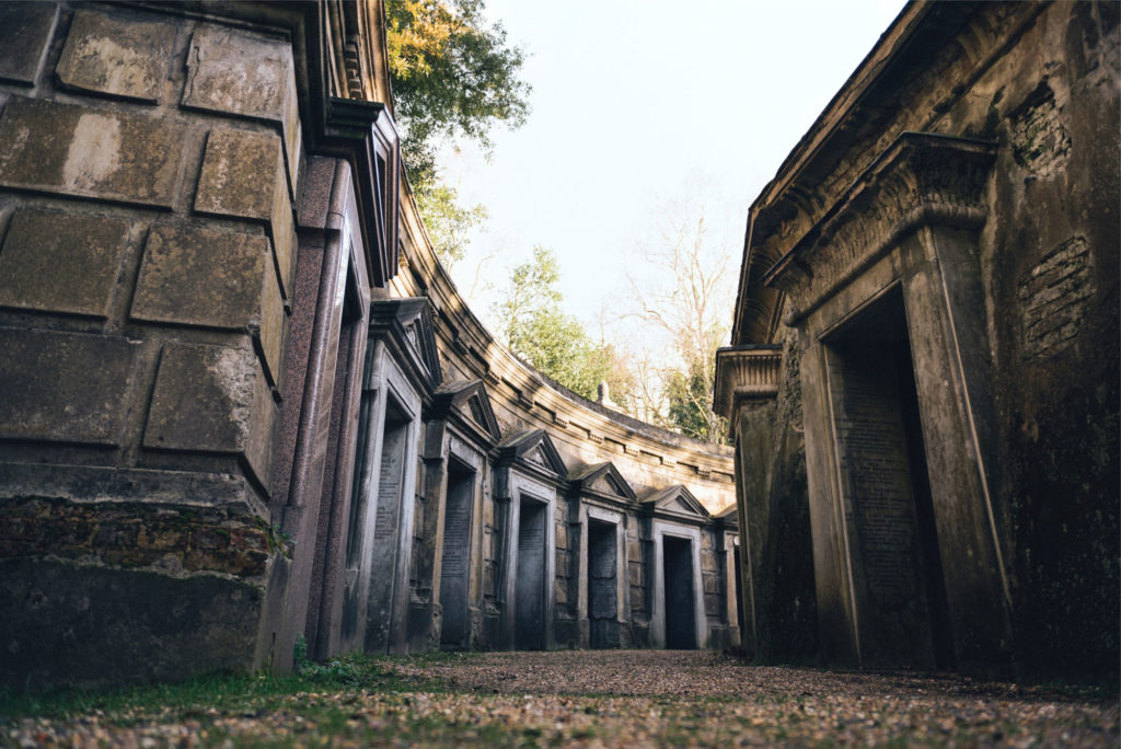 photograph of long curving row of mausoleum doorways