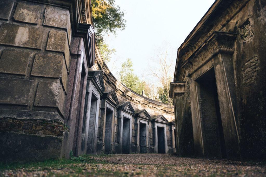 photograph of long curving row of mausoleum doorways