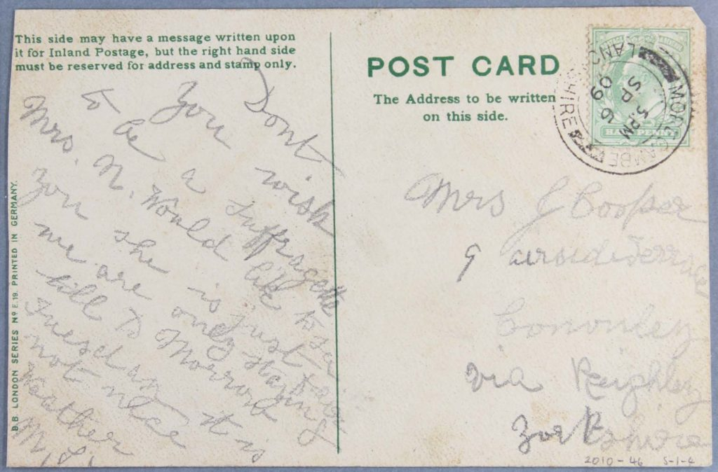 the reverse of an old postcard with a pencil written message
