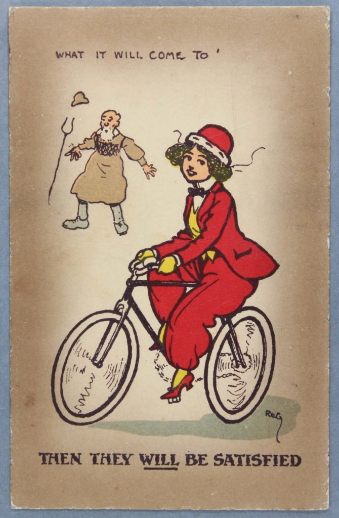 A postcard image of a woman on a bike. A man in the background has a caption that says 'What it will come to' and below it says 'Then they will be satisfied'.
