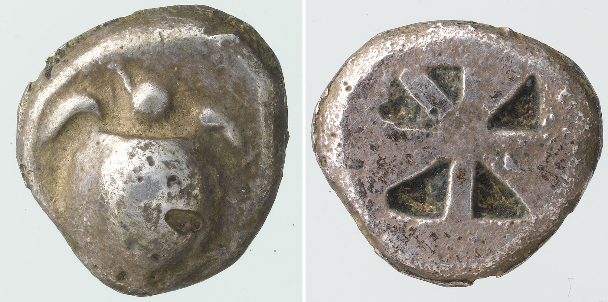 a photo of both sides of a crudely shaped coin with a turtle on it