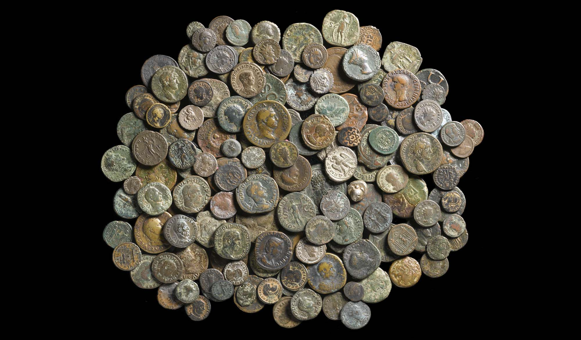 a photo of a large grouping of ancient coins