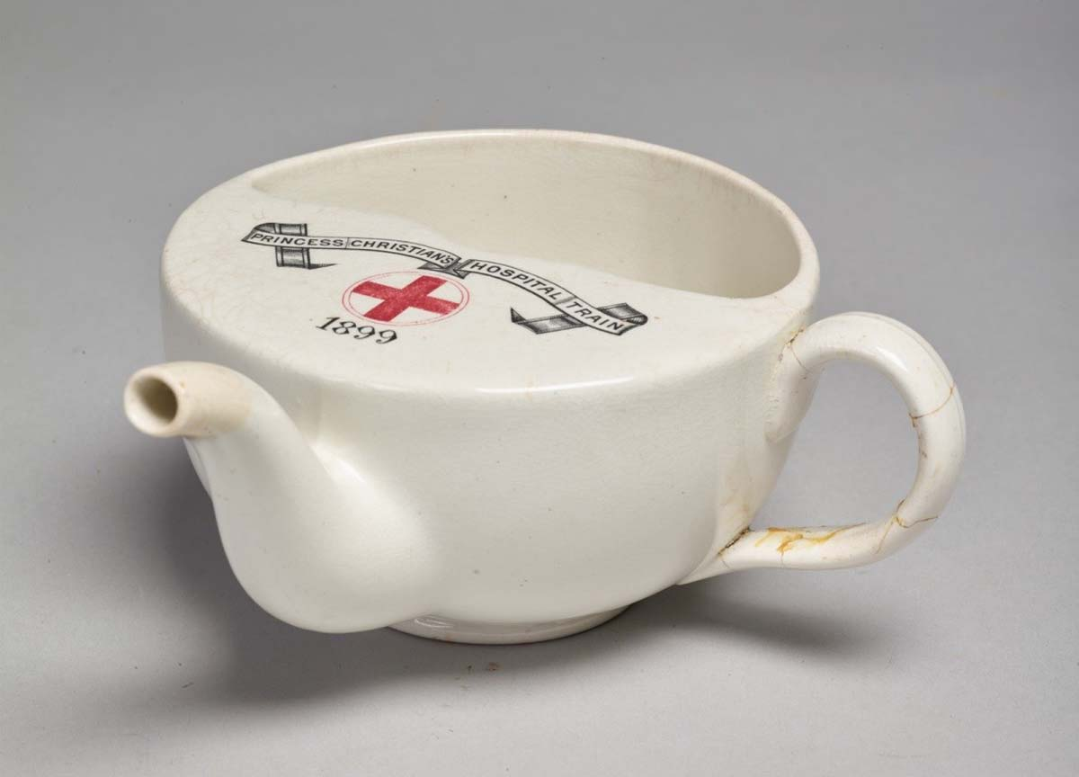 a photo of a cup with a teapot styled spout to its front