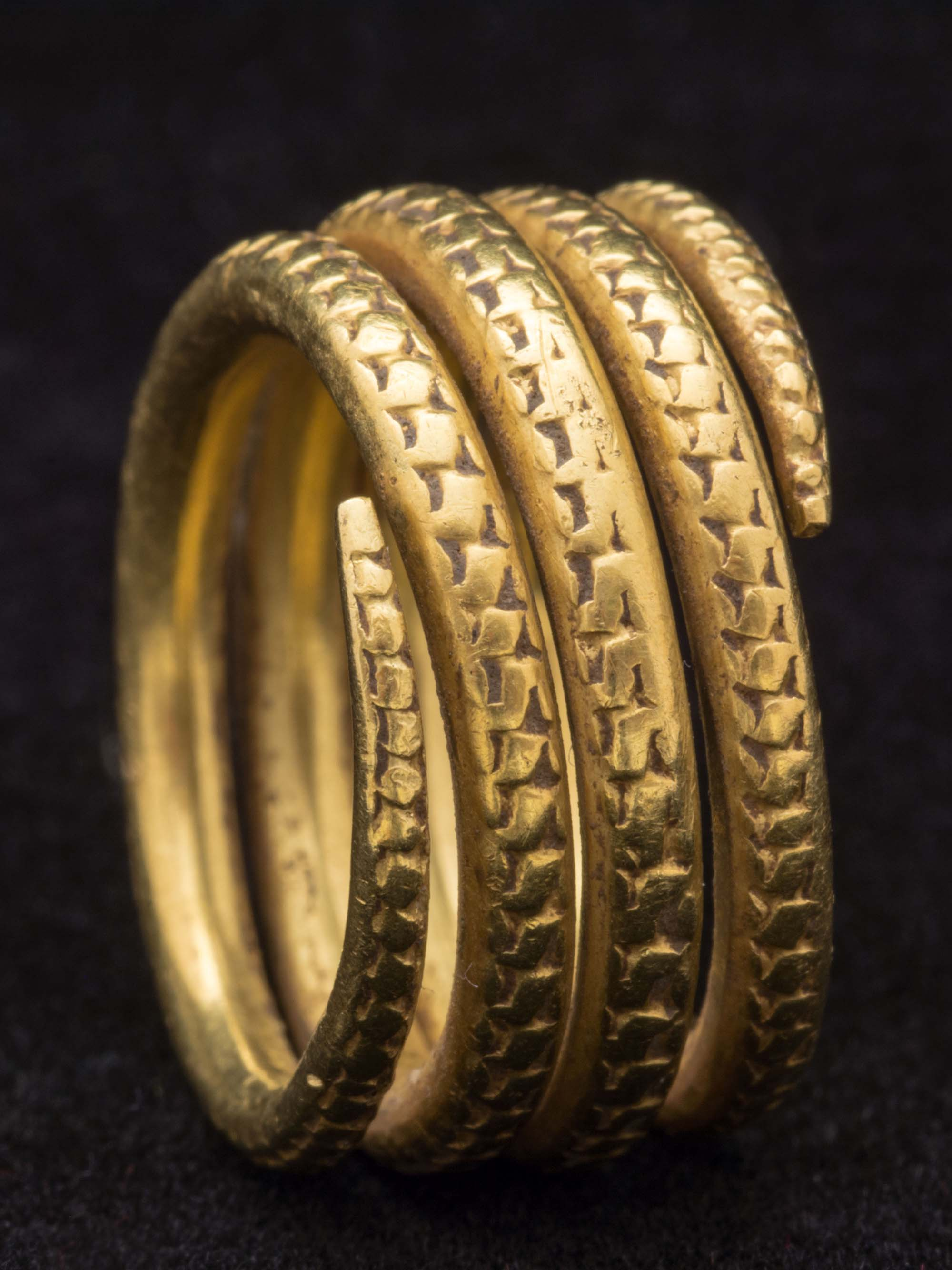 a photo of a gold coiled ring