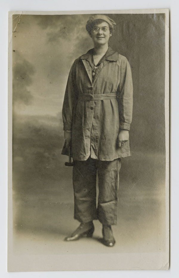 a photo of a woman wearing first world war factory worker's style clothing