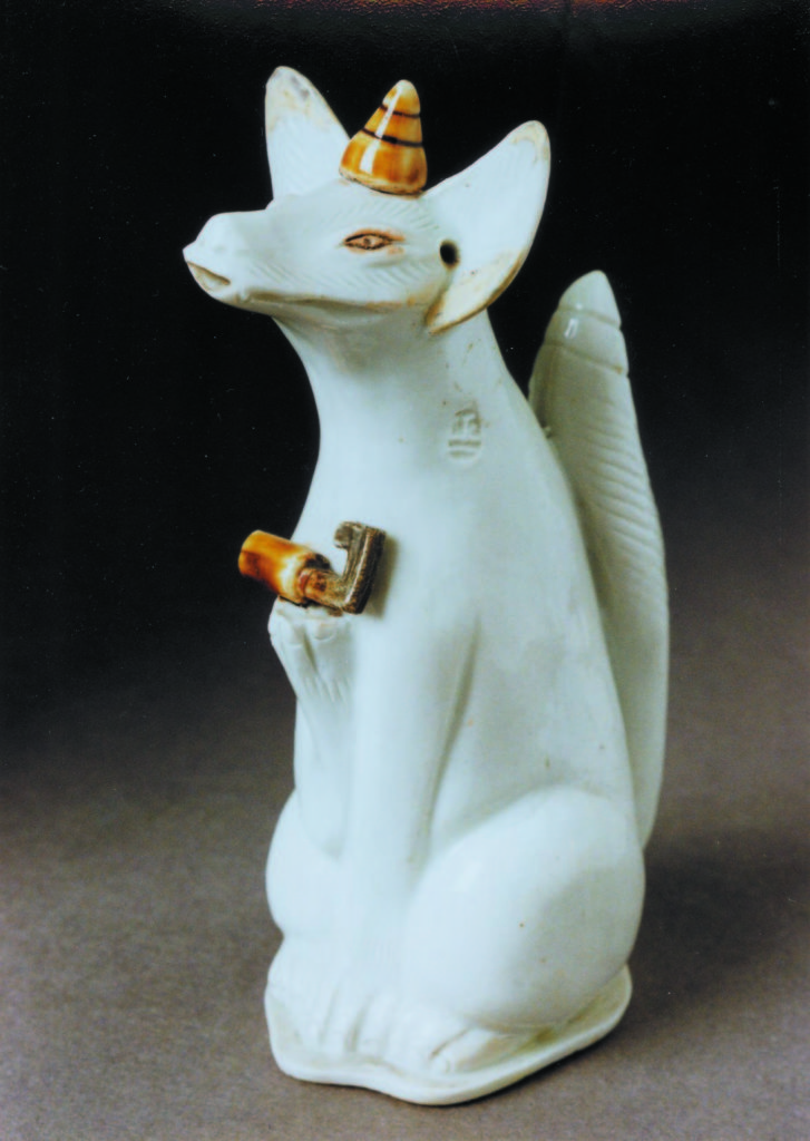 photograph of carved white fox figurine