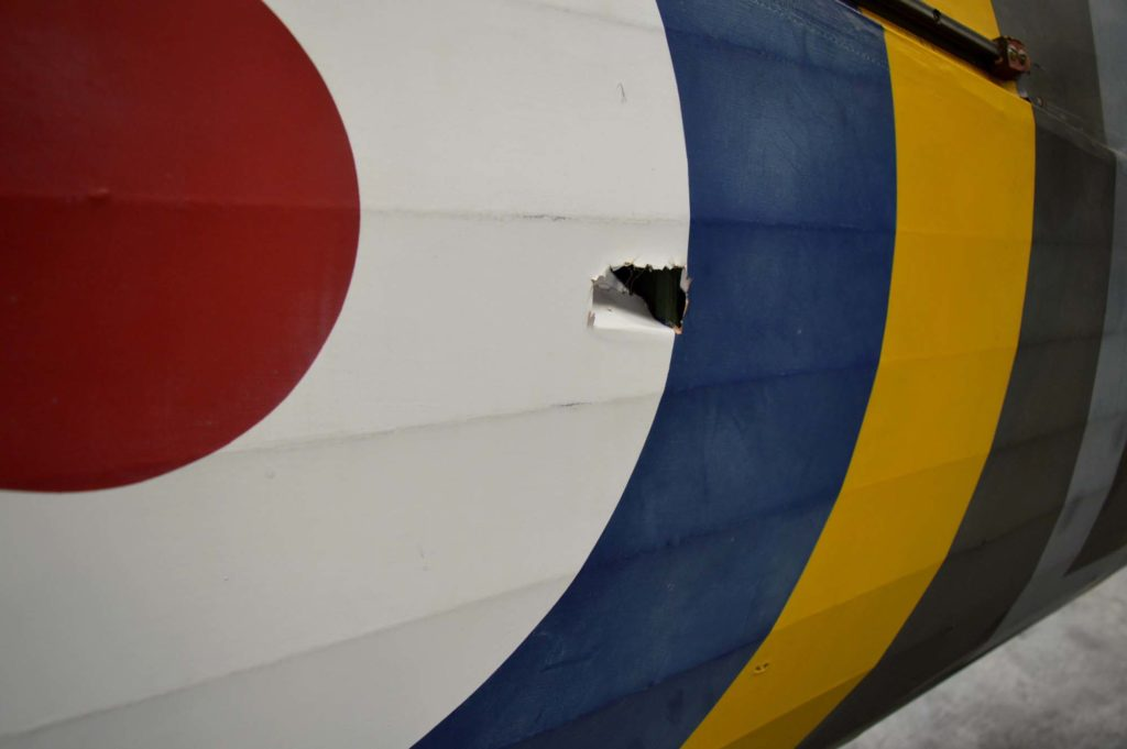 a close up of an RAF roundel with a hole in the fabric