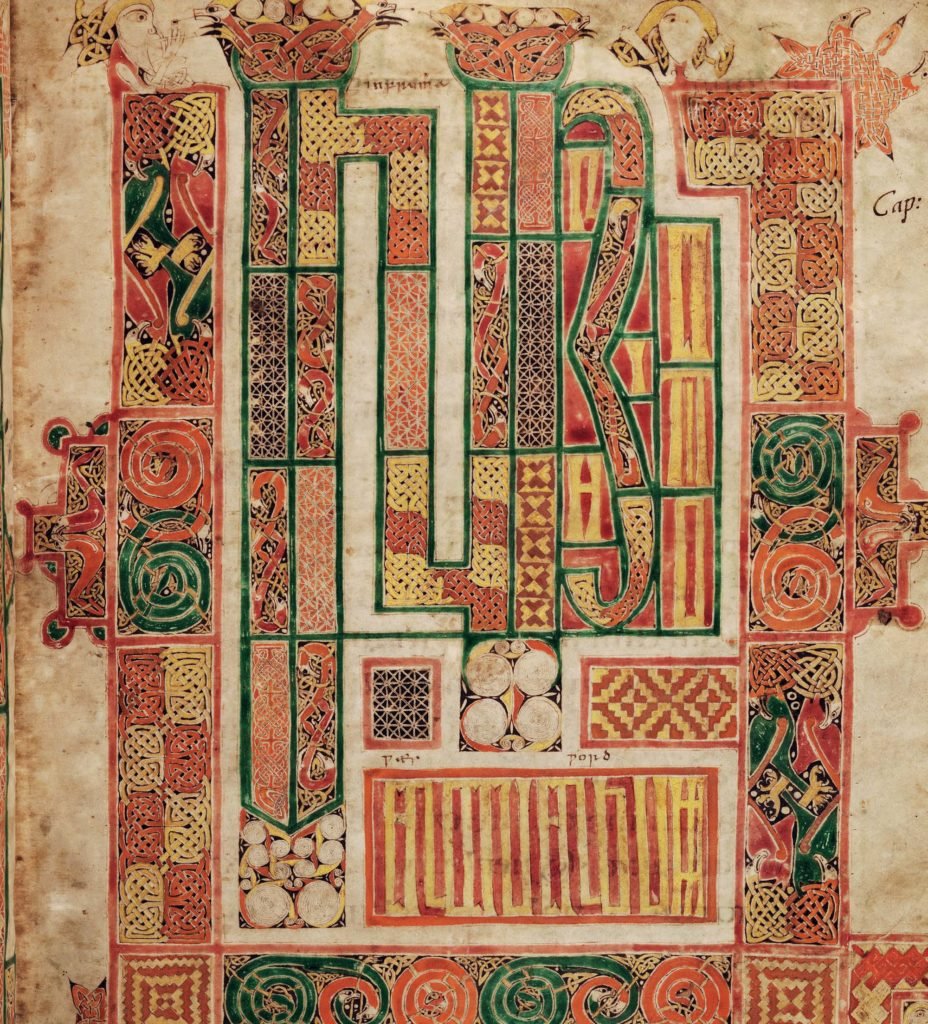 a photo of a manuscript with colourful block decoration