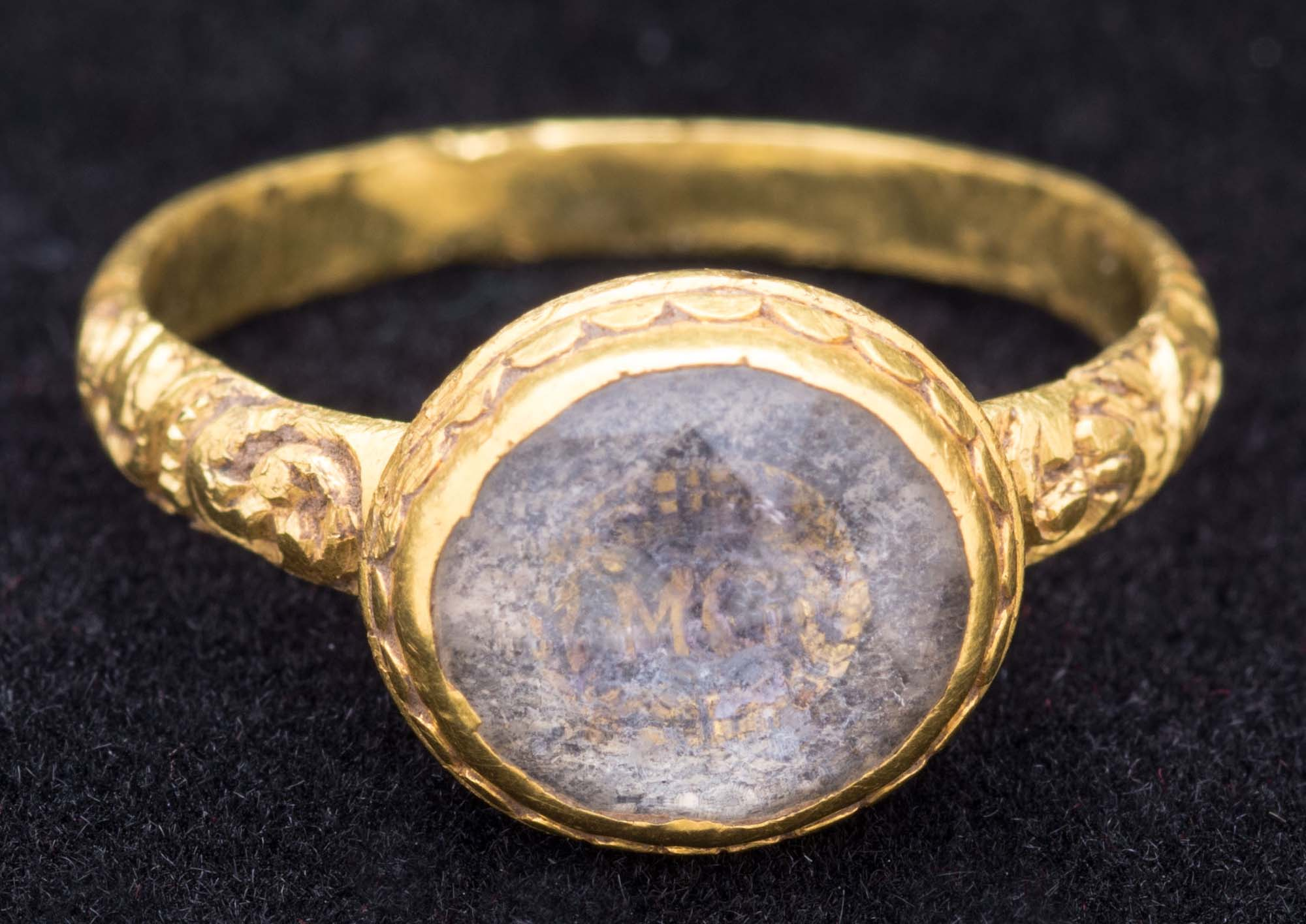 a photo of a gold ring with an opal centre