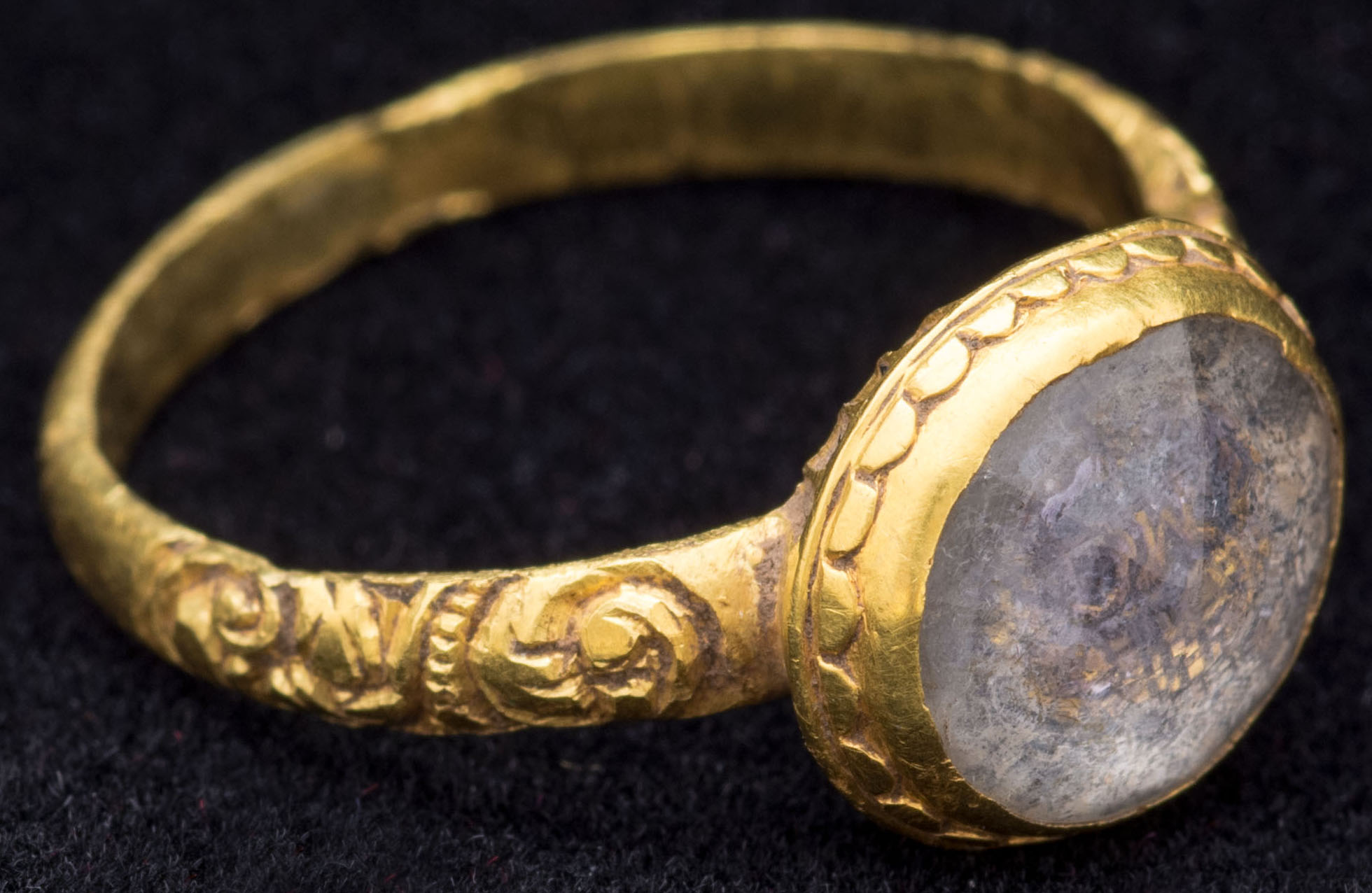 a photo of a gold ring with an opal in it