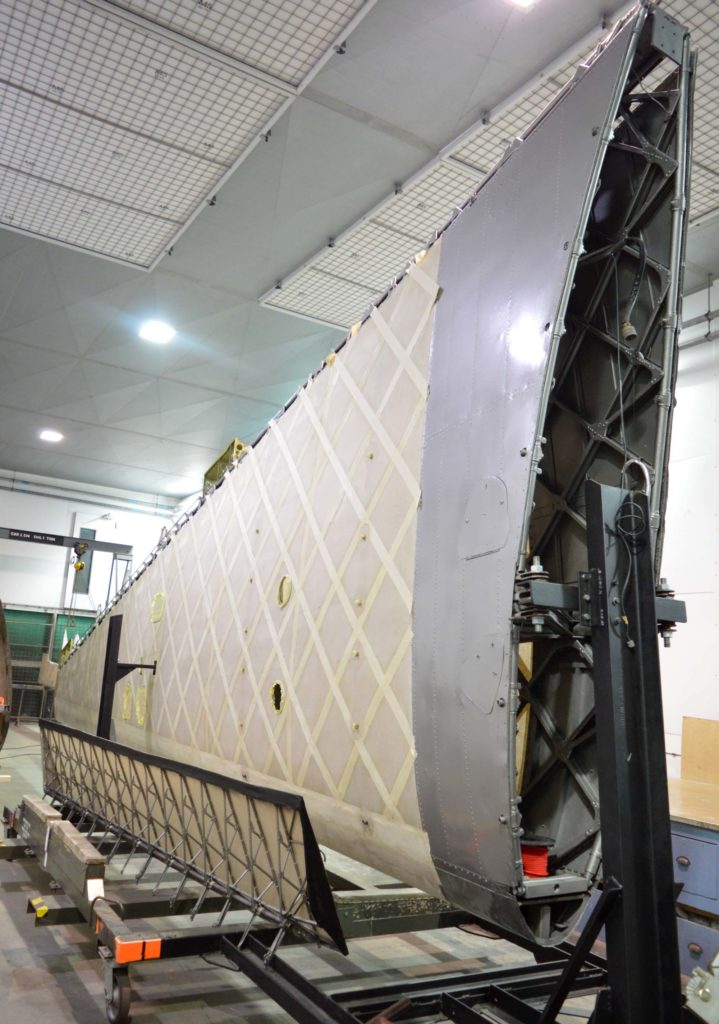 a photo of the detached wing of a Wellington bomber in unpainted state