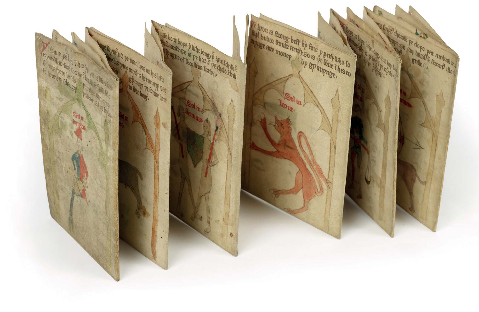 a photo of a concertina manuscript with medieval drawing visible inside its pages