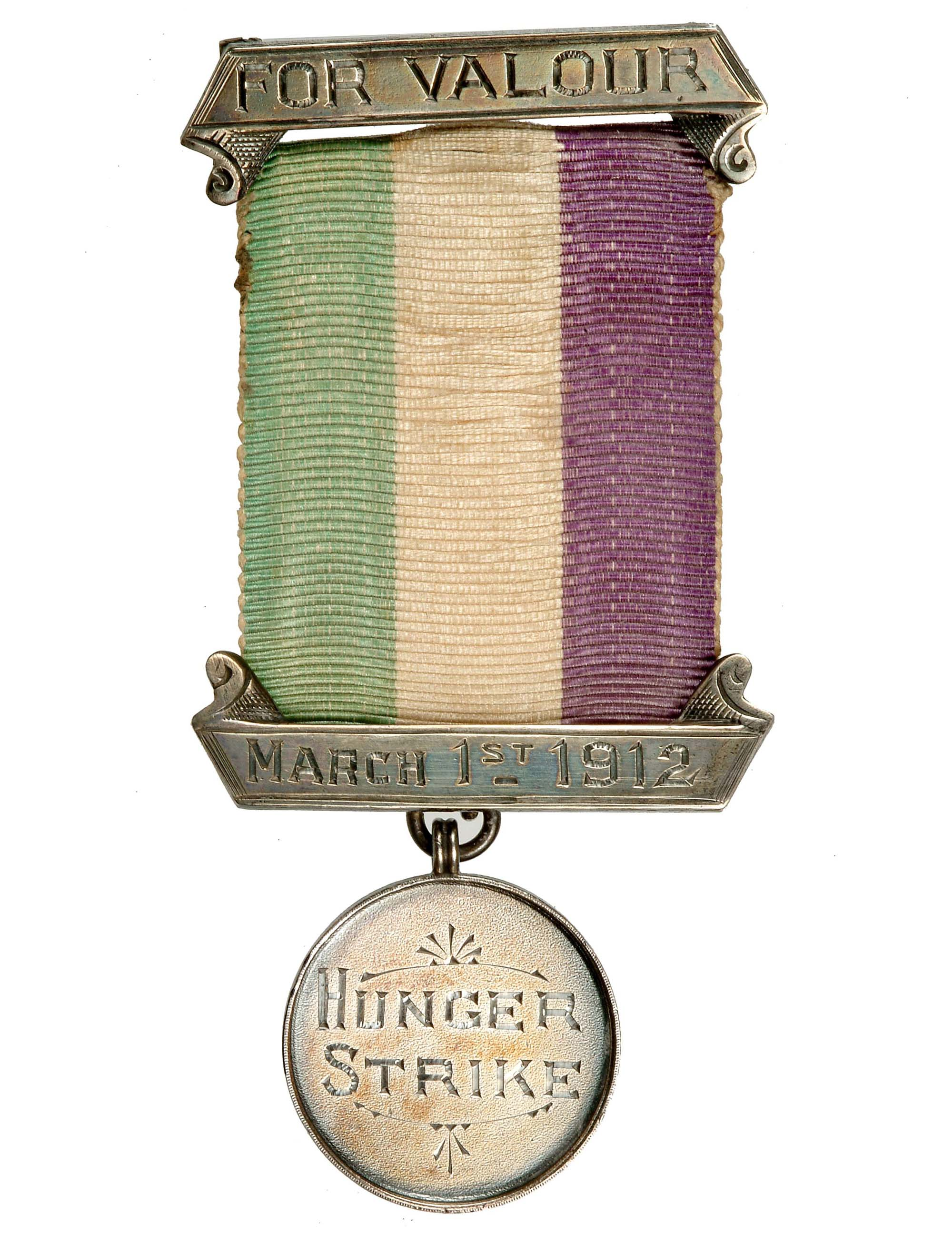 a photo of a medal with white green and purple ribbon