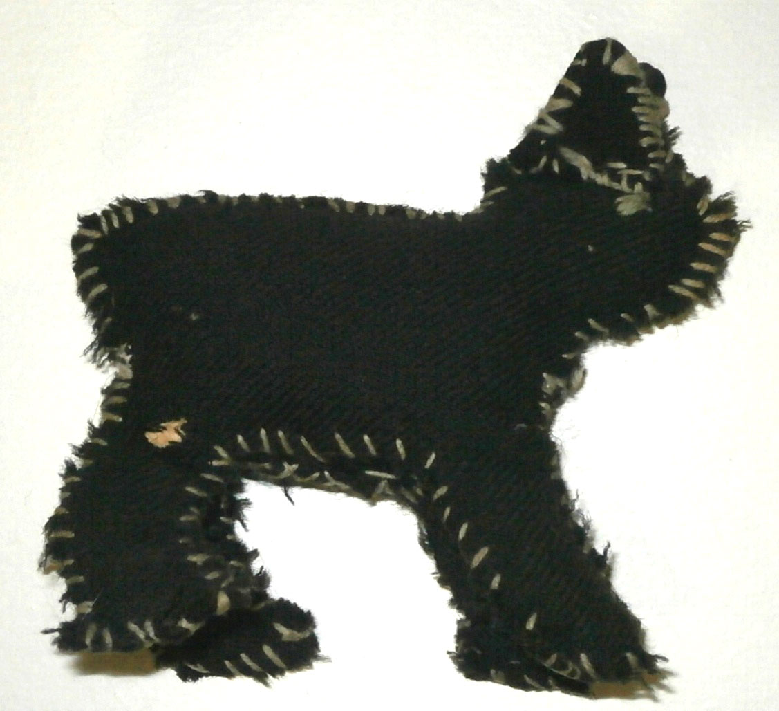 a hand sewn toy Manx cat