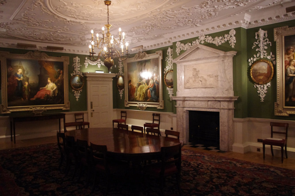 photograph of interior of regency building showing chandelier and paintings