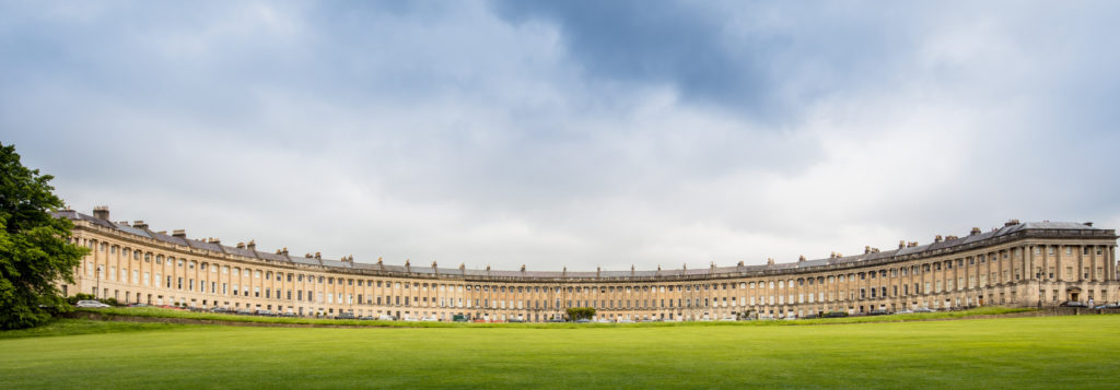photograph of long crescent of houses, green lawn in front