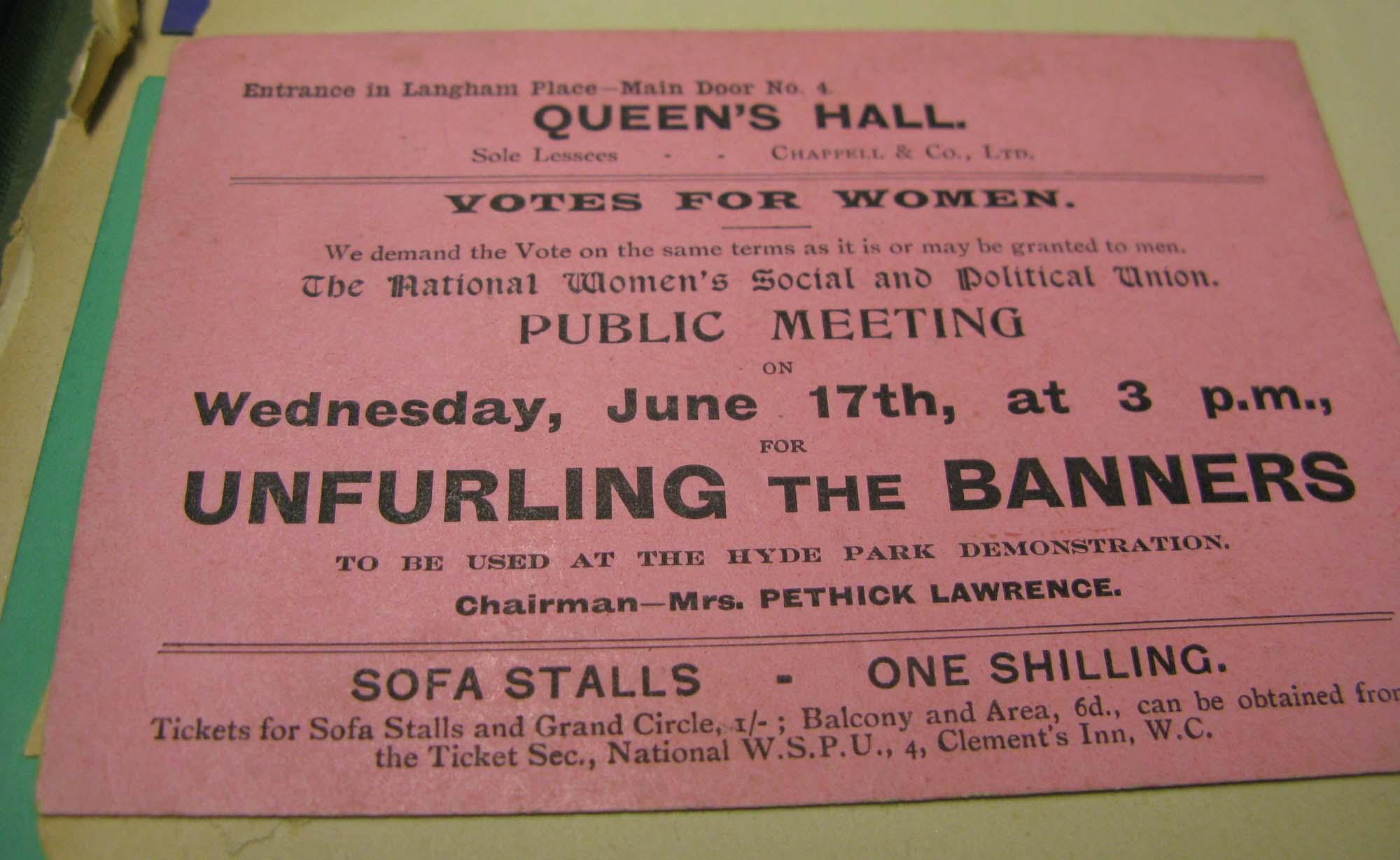 A pink suffragette meeting ticket stub