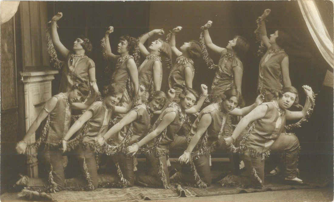 a photo of a group of women in a dance troupe