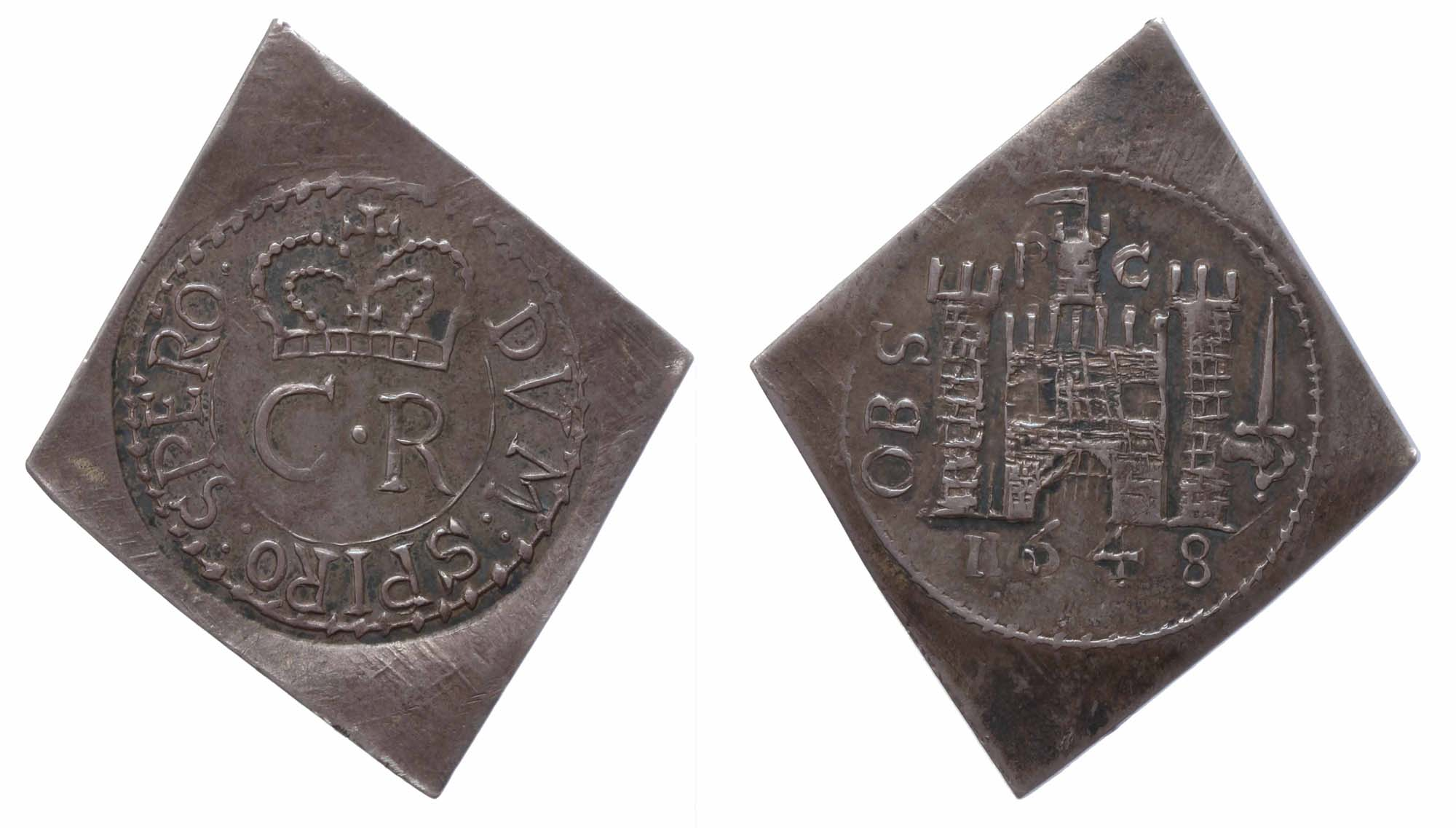 a roughly cast lozenge shaped coin with a castle image and royal cipher