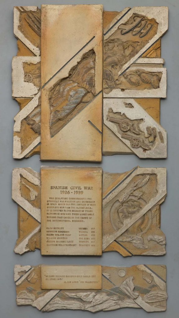 a photo of a relief sculpture showing soldiers and warfare
