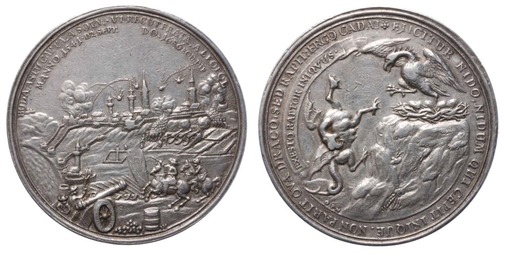 a photo of a coin showing one side depicting a siege scene and another showing a dragon and eagle