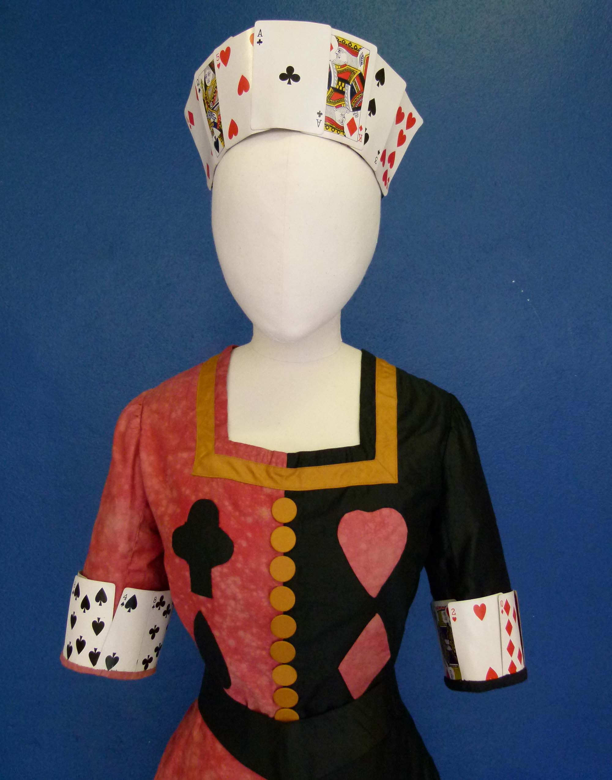 a photo of a dress on a mannequin with hearts and clubs motifs