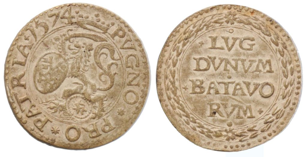 a photo showing two sides of a Dutch coin made of compressed paper