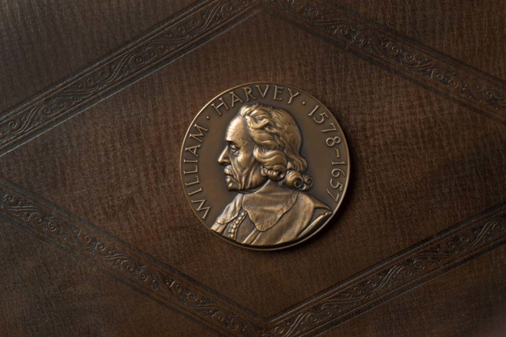 a photo of a struck coin with a profile image of William Harvey