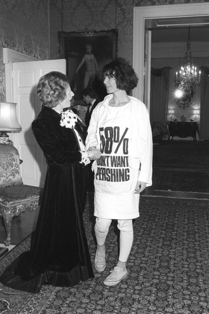 "black and white photograph showing Margaret Thatcher shaking hands with a woman wearing a tshirt reading ""58%"