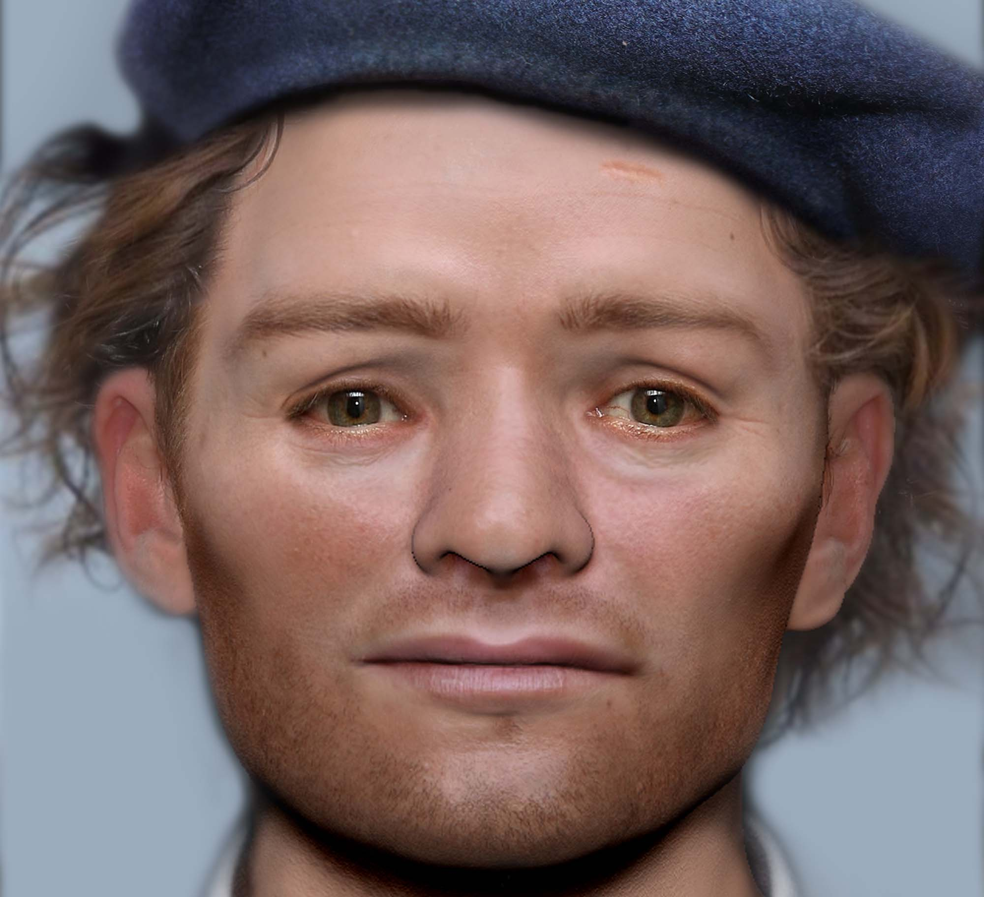 a computerised reconstructed face of a man with brown eyes and wispy auburn hair