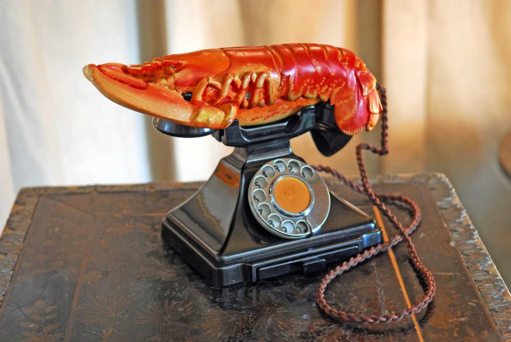 a photo of Salvador Dali's Lobster Telephone on a desk