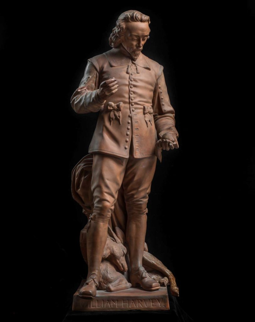 a small statuette of a man, William Harvey, in seventeenth century dress