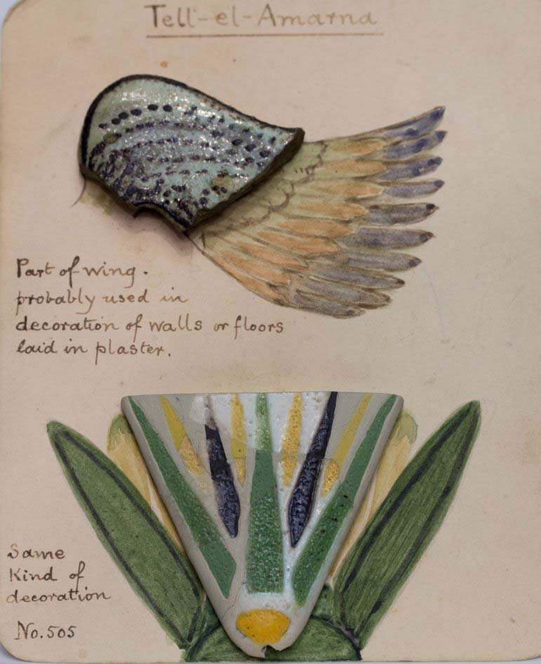 a photo of an sketchbook with fragments of Egyptian pottery and decorated stone