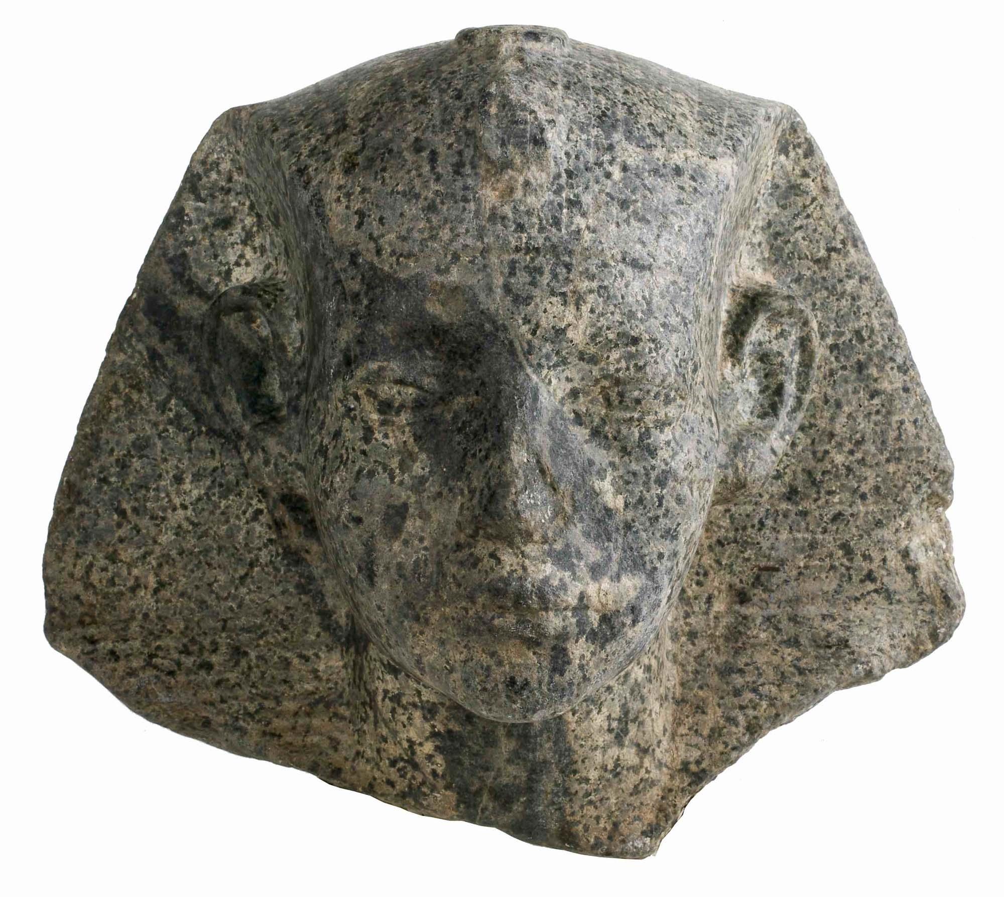photo of a carved head of an Egyptian Pharoah