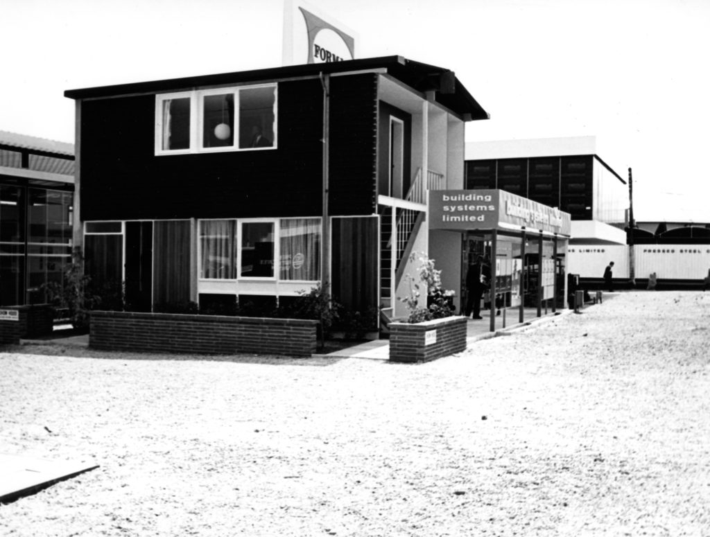 monochrome photograph of two-storey prefab home