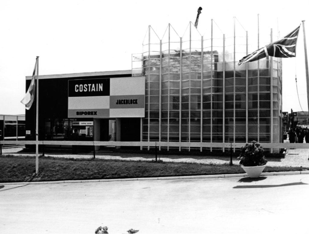 monochrome photograph of large prefab industrial building