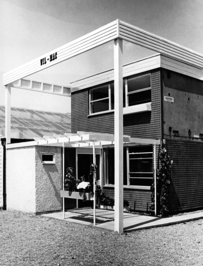 monochrome photograph of prefabricated two-storey home