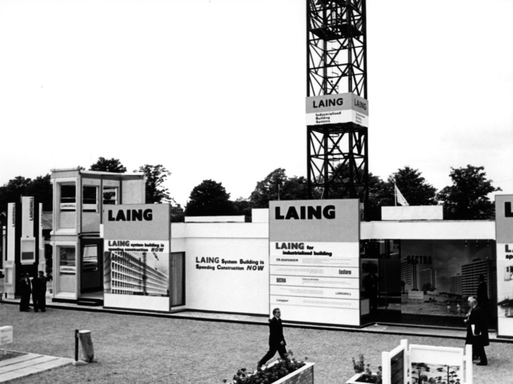 monochrome photograph showing advertising stand for prefab company LAING