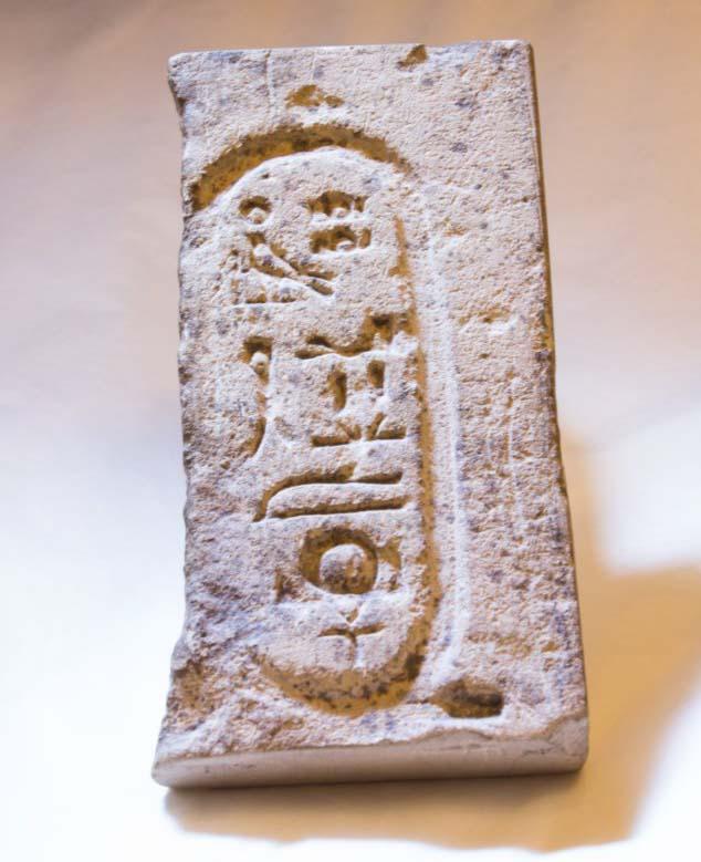 a photo of a stone fragment with Egyptian heiroglyphs