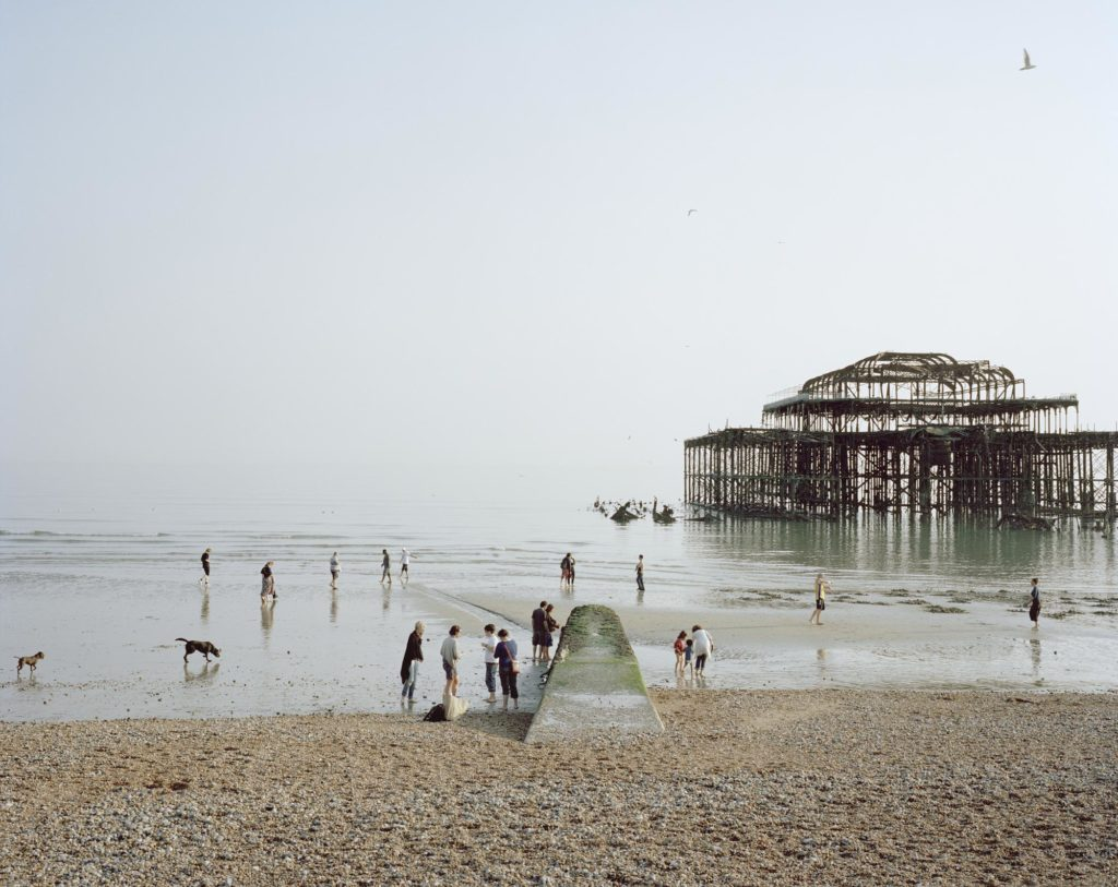 a colour photo of a the steel frame of Brighton West Pier seen from the beach