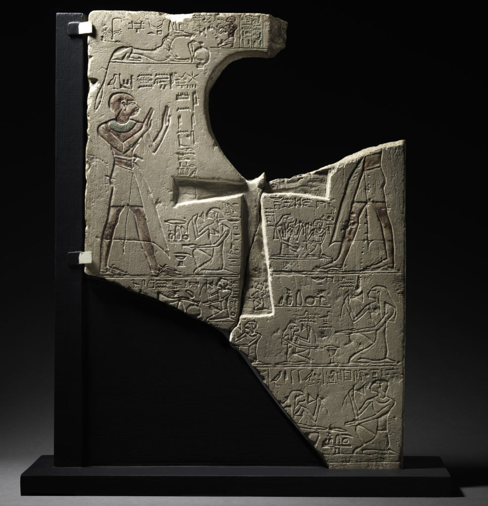 A photograph of an inscribed Egyptian stone with heiroglyphs at the Garstang Museum in Liverpool