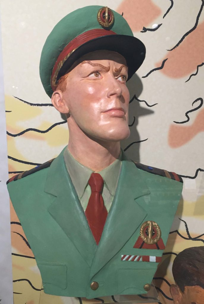 a plaster bust of a man in cap and uniform
