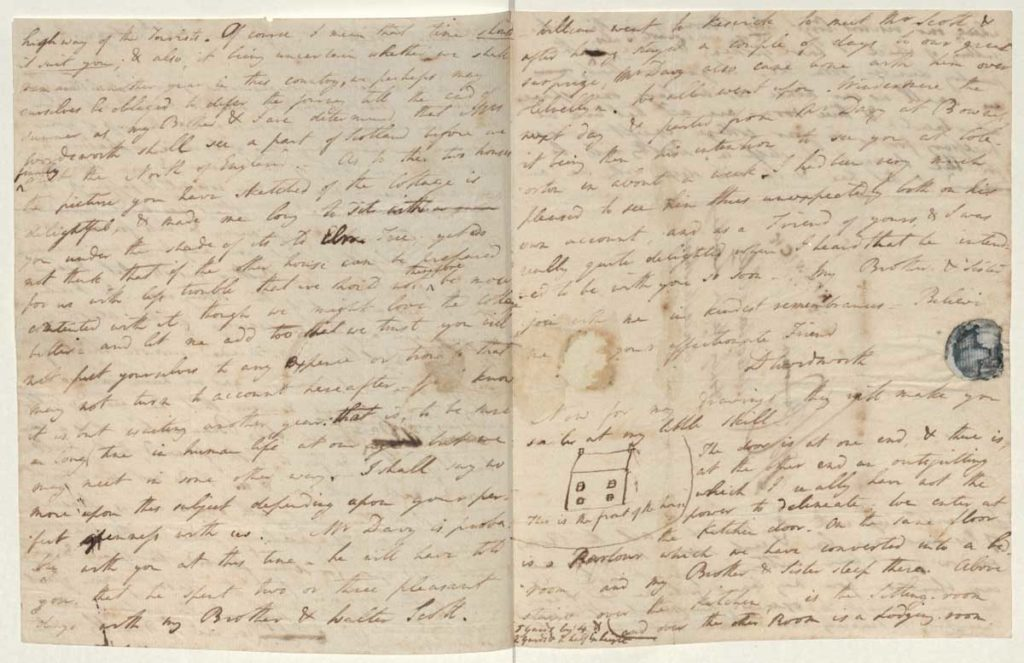 a photo of a handwritten letter with a small drawing of a house within the text