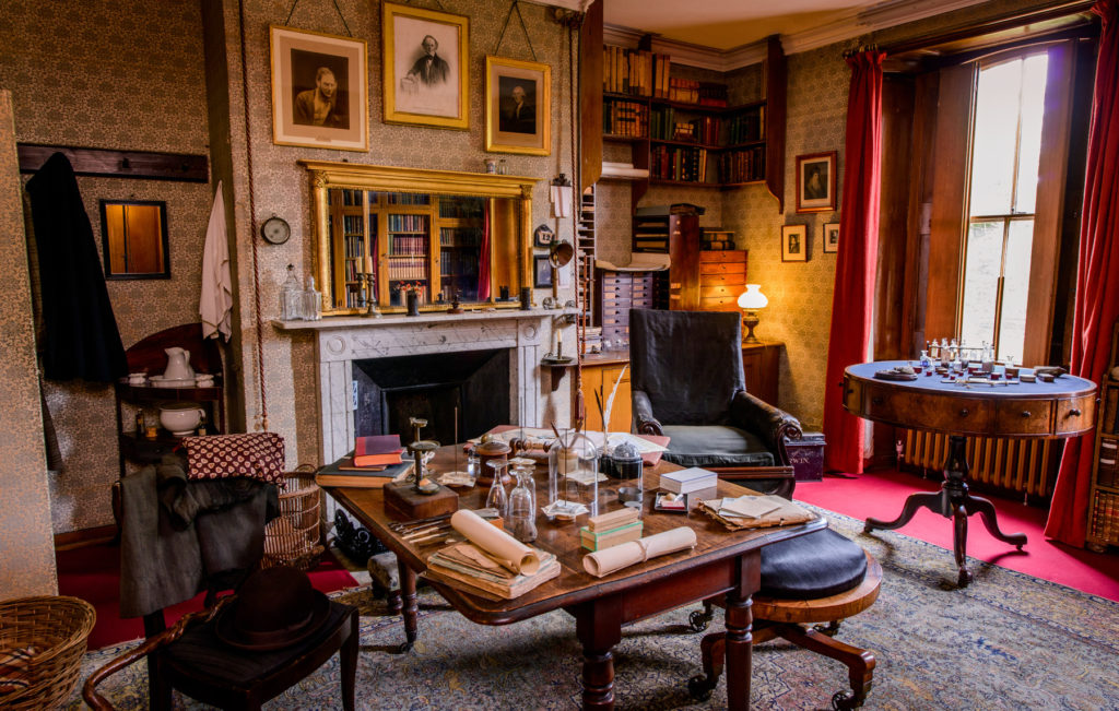 photograph of the interior of Charles Darwin's home, with Victorian style furnishings and scientific equipment