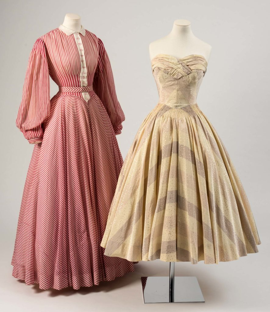 a photo of a Cream chiffon dress and a Red and white ͚ candy-striped cotton evening dress with full sleeves