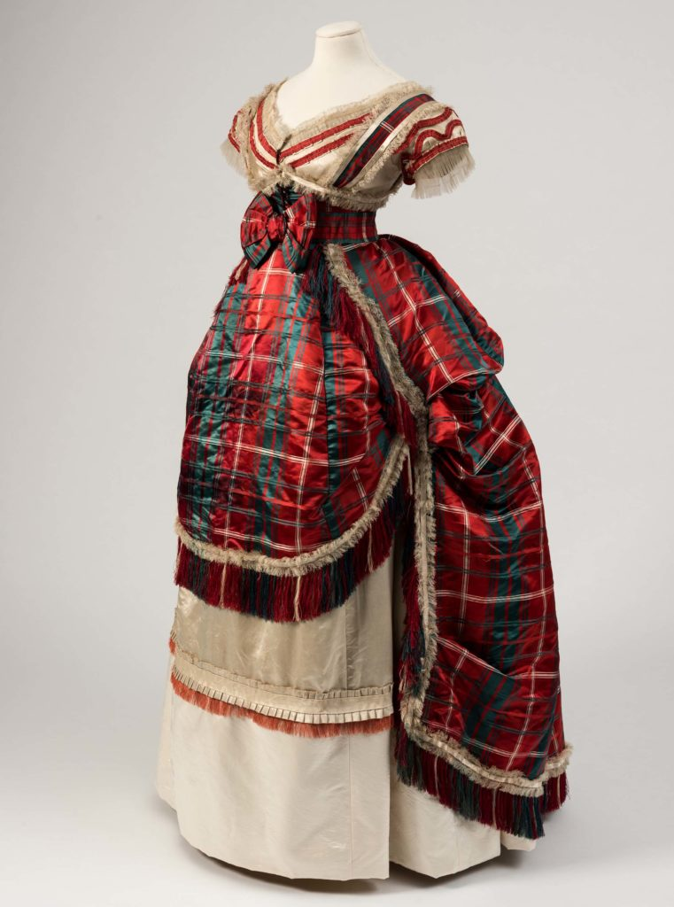 a photo of a red tartan dress with rear ruffle