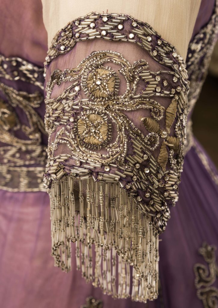 a detail of metal thread on an evening gown